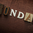 The word monday written on wooden background — Stock Photo