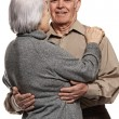 Portrait of a happy senior couple embracing each other — Stock Photo #12352763