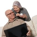 Senior couple on laptop — Stock Photo