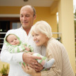 Grandparents with his grandchild - Stock Photo