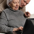 Senior couple on laptop — Stock Photo