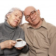 Happy senour couple drinking coffee — Stock Photo