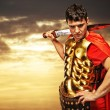 Roman legionary soldier against cloudy sky — Stock Photo