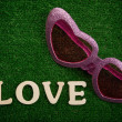 The word love written on green background - Stockfoto