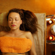 Beautiful woman relaxing in a massage salon — Stock Photo #12352957