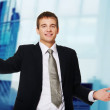 Happy young businessman with open hands — Stock Photo #12353078