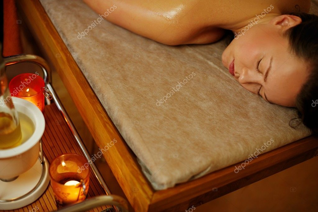 Beautiful woman relaxing in a massage salon — Stock Photo #12352939