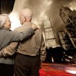 Royalty-Free Stock Photo: Senior couple looking at modern city