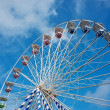 Ferris wheel against blue sky - 图库照片
