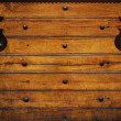 Metal hinges on wooden background — Stock Photo