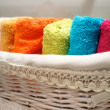 Colorful towels in basket - 图库照片