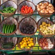 Stock Photo: Vegetables in baskets on market place