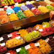 Sweets on market stall in La Boqueria, Barcelona - Stock Photo