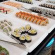 Sushi on plates in a restaurant - Foto Stock