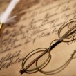 Old glasses on vintage letter — Stock Photo
