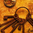 Bunch of keys with a gears on the old textured paper — Stock fotografie