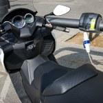 Motorbike electro charging — Stock Photo #12373946