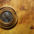Vintage compass on the old map — Stock Photo #12373977