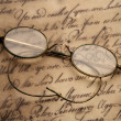Stock Photo: Old glasses on the vintage document