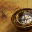 Stock Photo: Vintage compass on the old map