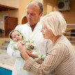 Grandparents with their grandchild - Stock Photo