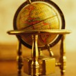 Vintage globe on a table — Stock Photo