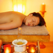 Woman relaxing in massage salon — Stock Photo