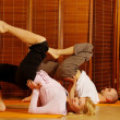 Couple doing yoga exercise — Foto Stock