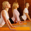 Group doing yoga exercise — Stock Photo