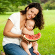 Mother with her child outdoors — Stock Photo