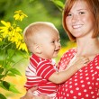 Mother with her child outdoors — Stock Photo #12374321