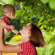 Mother with her child outdoors — Stock Photo #12374335