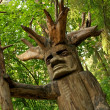 Pagan wooden idol in a woods — Stock Photo