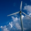 Wind turbine against blue sky — Stock Photo #12374419