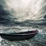 barco abandonado no mar tempestuoso — Fotografia Stock  #12374477