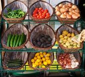 Vegetables in baskets on market place — Stock Photo