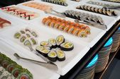 Sushi on plates in a restaurant — Stock Photo
