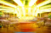 Merry-go-round in motion blur — Stock Photo