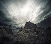 Dramatic sky over rocks — Stock Photo