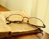 Glasses on vintage book. — Stock Photo