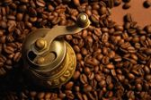 Coffee background with coffee mill — Stock Photo