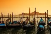 Gondolas against Venice panorama — Stock Photo