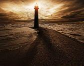 Gewitterhimmel über leuchtturm — Stockfoto