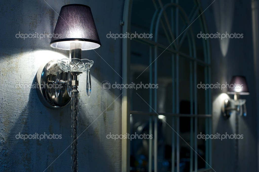 Vintage crystal candelabra on wall. — Stock Photo #12374021