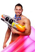 Şilte ile plajda seksi bir adam portresi — Stok fotoğraf