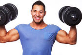 Portrait of muscle man on white background with dumbbels — Stock Photo