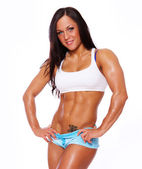 Portrait of muscle woman posing in gym — Stock Photo