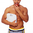 Portrait of man with scales eating apple — Stock Photo