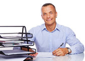 Portrait of handsome man posing in studio with office stuff — Stock Photo