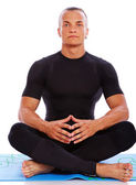 Portrait of handsome man meditating in studio on white backgroun — Stock Photo